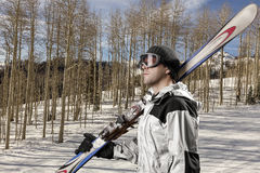 Skier holding a pair of skis Stock Image