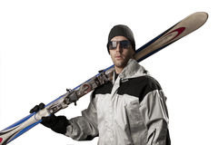 Skier holding a pair of skis Stock Photos