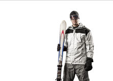Skier holding a pair of skis Royalty Free Stock Photos
