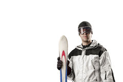Skier holding a pair of skis Royalty Free Stock Photo