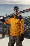 Skier holding a pair of skis Stock Images