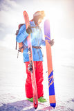 Skier holding ski on snowy mountains. Full length skier holding ski on snowy mountains Royalty Free Stock Photos
