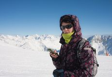 Skier In The Mountains With A Mobile Phone Royalty Free Stock Images
