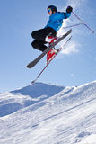 Skier in a jump. A skier in a very high jump bevor the sky Stock Photo