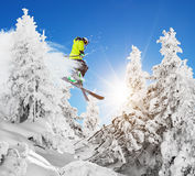Skier at jump in Alpine mountains Royalty Free Stock Photography
