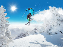 Skier at jump in Alpine mountains Royalty Free Stock Image