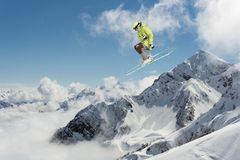 Skier jump in the mountains. Extreme ski sport. Freeride. Skier jump in the snowy mountains. Extreme ski sport. Freeride Royalty Free Stock Photo