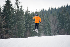 Skier at jump from the slope of mountains Stock Images