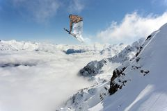 Skier jump in the mountains. Extreme ski sport. Freeride. Skier jump in the snowy mountains. Extreme ski sport. Freeride Royalty Free Stock Image