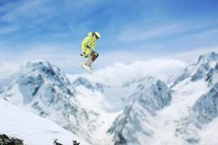 Skier jump in the mountains. Extreme ski sport. Freeride. Skier jump in the snowy mountains. Extreme ski sport. Freeride Stock Images