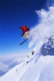Skier jumping. With cloud of snow