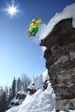 Skier jumping against blue sky Stock Image