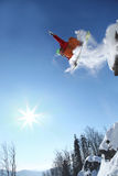 Skier jumping against blue sky Royalty Free Stock Images