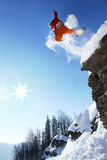 Skier jumping against blue sky Royalty Free Stock Image