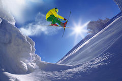 Skier jumping against blue sky from the rock. In high mountain Royalty Free Stock Photography