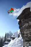 Skier jumping against blue sky from the rock Stock Photography