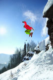 Skier jumping against blue sky from the rock Royalty Free Stock Photography