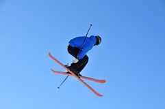Skier jumping with crossed skis Royalty Free Stock Photography