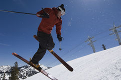 Skier Jumping In Midair. Low angle view of a skier jumping in midair Stock Photo