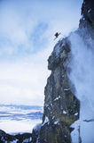Skier Jumping From Mountain Cliff Stock Images