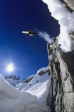 Skier Jumping From Mountain Cliff Royalty Free Stock Photography