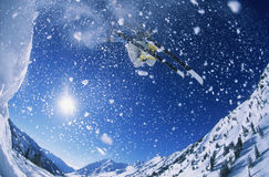 Skier Jumping From Mountain Ledge Royalty Free Stock Images