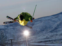 Skier jumping. Pro free style skier jumping from super half pipe of Buttermilk resort in Aspen, Colorado Royalty Free Stock Images