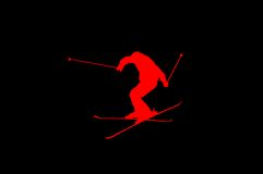 Skier jumping red on black Royalty Free Stock Photography
