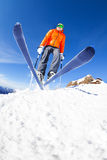 Skier jumping view from below during winter day. Skier jumping from slope view from below during sunny winter day on Krasnaya polyana ski resort and Caucasus Royalty Free Stock Image