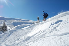 Skier jumps. From a cliff in snow powder. Ukraine, Carpathians, Dragobrat Stock Image