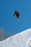 Skier Jumps High. Skier Soars into the air Royalty Free Stock Photography