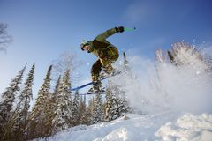 The skier jumps from a springboard in the ski resort. Stock Images