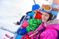 Skier kids on ski lift Royalty Free Stock Photography