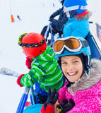 Skier kids on ski lift Royalty Free Stock Photo