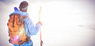 Skier looking at beautiful snow-covered mountains. Rear view of skier looking at beautiful snow-covered mountains Stock Image