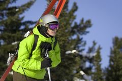 Skier looking for a ride. Freeride skier looking for a ride Royalty Free Stock Image