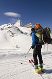 Skier looking at snow covered mountains. Skier looking out over mountain landscape Stock Image
