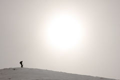 Skier. A male skier on the top of the si slope Stock Images