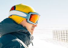 Skier man close up portrait. Wearing ski goggles Stock Image