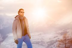 Skier man detail wearing anorak jacket with sunglasses portrait. exploring snowy land walking and skiing with alpine ski Royalty Free Stock Photography