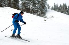 Skier man in mountains Royalty Free Stock Image