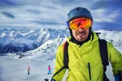 Skier man in winter mountains Stock Photos