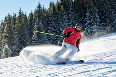 Skier maneuvering on a slope royalty free stock image