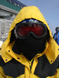Skier in mask. Skier in black balaclava mask and ski goggles stock photos