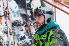 Skier in the mask on the face of a snow man and snow skis stock photography