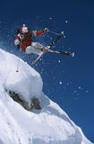 Skier In Midair Above Snow On Ski Slope Royalty Free Stock Photography