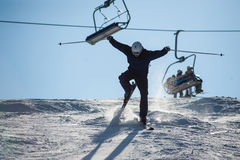 Skier in the moment of falling on the snowy slope Royalty Free Stock Photo