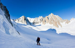 Skier in Mont Blanc Massif. Skier looking at view: Mont Blanc Massif peaks, Chamonix, France royalty free stock photography