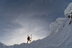 Skier on a mountain ridge in the winter royalty free stock images