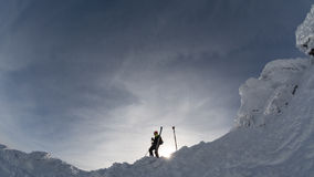 Skier on a mountain ridge in the winter Stock Images